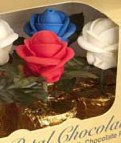 Unique Candy Roses - a royal icing edible rose on faux green leaves grown in a chocolate pot ! Packed 6 per box, shown  Americana Roses. jpg.